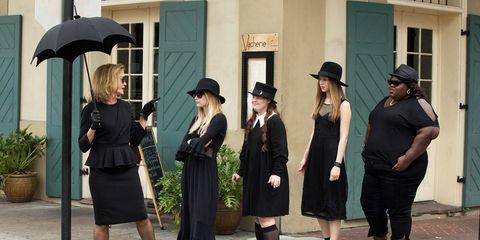 Clothing, Leg, Hat, Trousers, Outerwear, Standing, Flowerpot, Style, Coat, Street fashion,