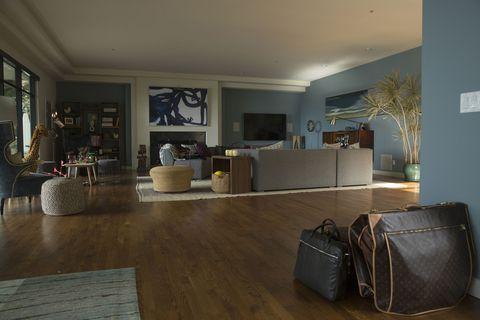Floor, Interior design, Flooring, Ceiling, Room, Wood flooring, Bag, Couch, Laminate flooring, Luggage and bags,