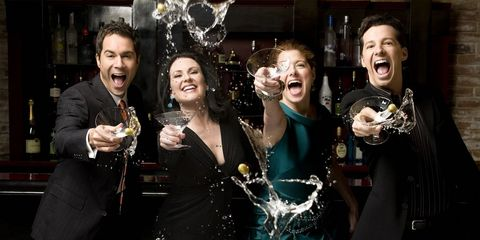 Smile, Dress, Coat, Wine glass, Party, Laugh, Little black dress, Stemware, Celebrating, Cocktail dress,