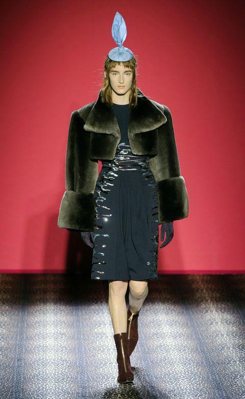 Sleeve, Outerwear, Costume design, Costume accessory, Dress, Headgear, Fashion, Headpiece, Fashion model, Knee,