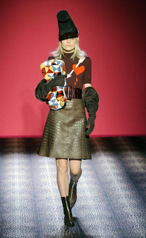 Headgear, Costume accessory, Fashion, Costume, Costume design, Knee, Costume hat, Beanie, Fur, Street fashion,
