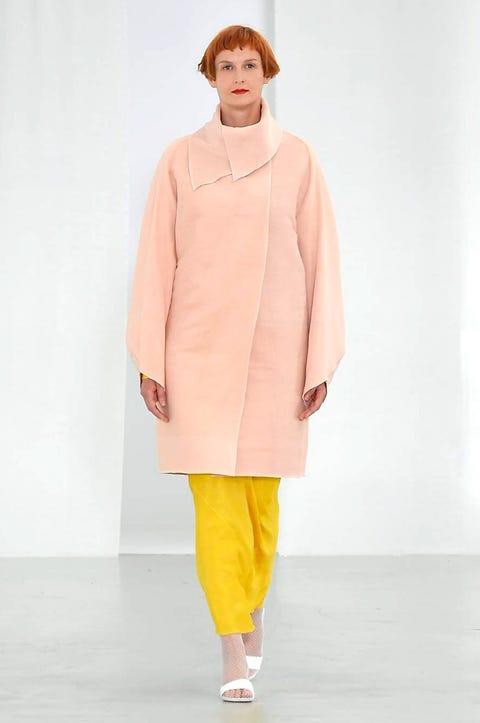 Sleeve, Textile, Standing, Fashion, Costume design, Street fashion, Fashion model, Fashion show, Fashion design, Peach,