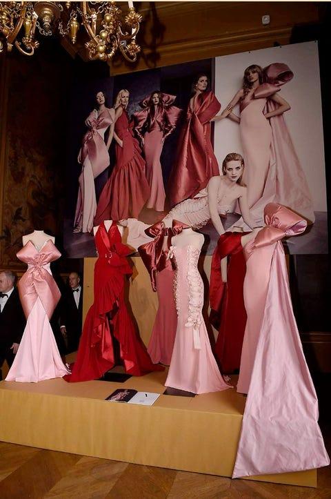Pink, Gown, Light fixture, Fashion, Dress, Interior design, Chandelier, Stage, Costume design, Costume,