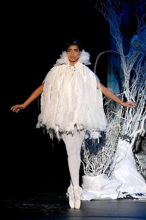 Dress, Fashion, Costume design, Stage, Flash photography, Dancer, Performance art, Costume, Embellishment, Twig,