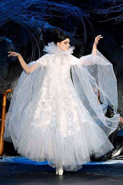 Dress, Gown, Costume design, Wedding dress, Fashion, Veil, Bridal clothing, Embellishment, Costume, Haute couture,
