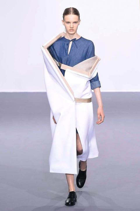 Footwear, Shoe, Costume design, Fashion, Fashion model, Fashion show, High heels, Sandal, Silk, Model,