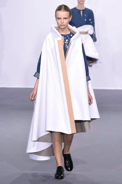 Shoulder, Fashion, Costume design, Fashion design, High heels, Cloak, Sandal, Costume, Mantle, Ankle,
