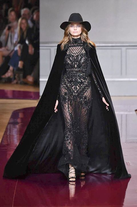 Human, Textile, Formal wear, Hat, Costume design, Gown, Fashion, Fashion model, Black hair, Costume accessory,