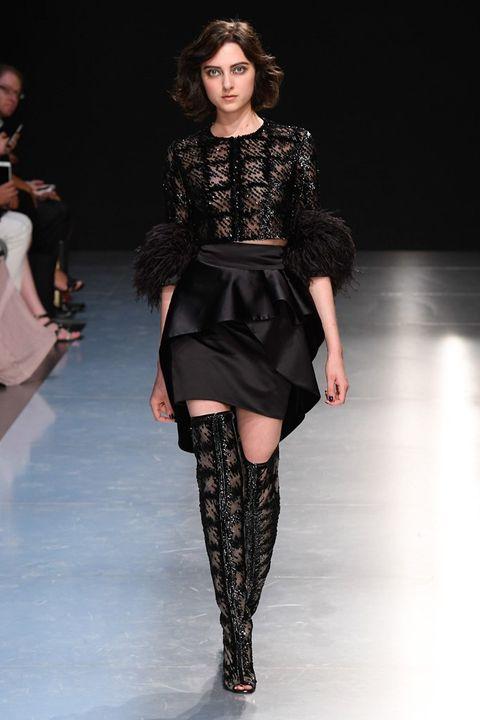 Human, Fashion show, Human body, Shoulder, Runway, Joint, Outerwear, Fashion model, Style, Knee,