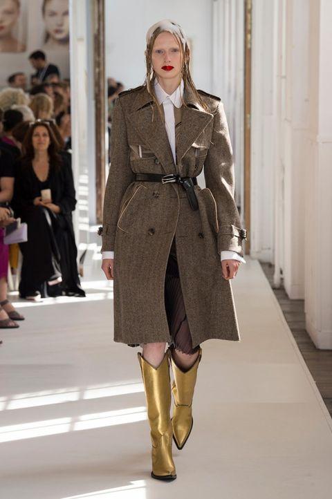 Fashion model, Fashion, Clothing, Fashion show, Runway, Coat, Overcoat, Outerwear, Knee, Street fashion,