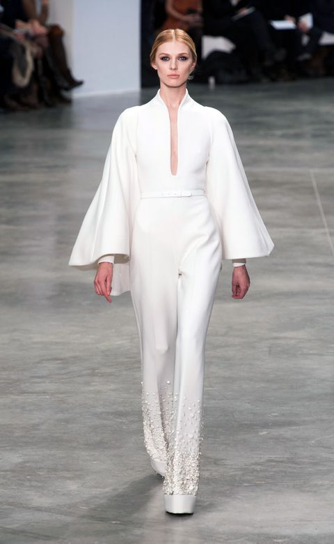 Fashion show, Sleeve, Skin, Shoulder, Joint, Outerwear, Fashion model, Style, Runway, Formal wear,