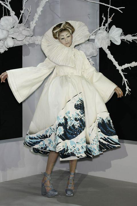 Clothing, Style, Costume design, Dress, One-piece garment, Headgear, Fashion, Costume, Day dress, High heels,