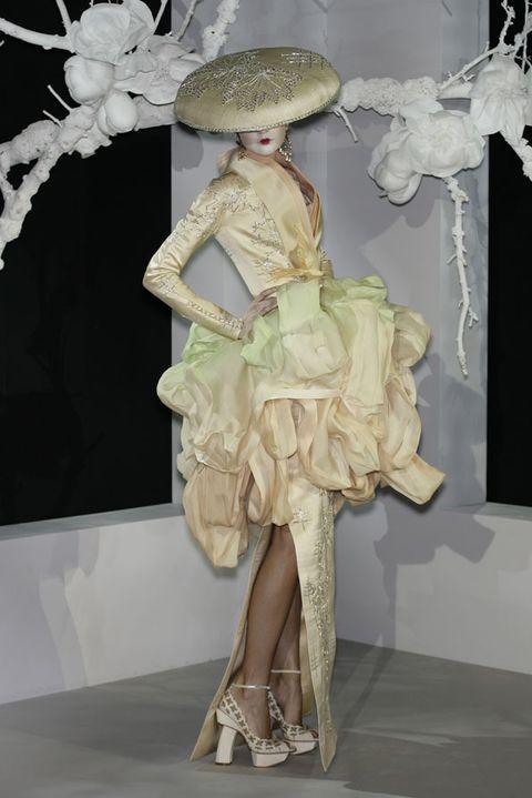 Dress, Costume accessory, Costume design, Fashion, One-piece garment, Beige, Day dress, Embellishment, Twig, Costume,