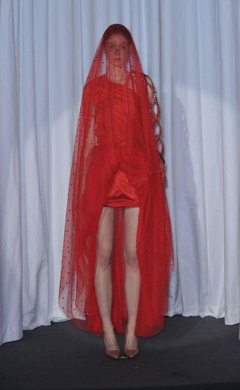 Textile, Long hair, Costume, High heels, Carpet, Curtain, Sandal, Foot, Costume design, Ankle,