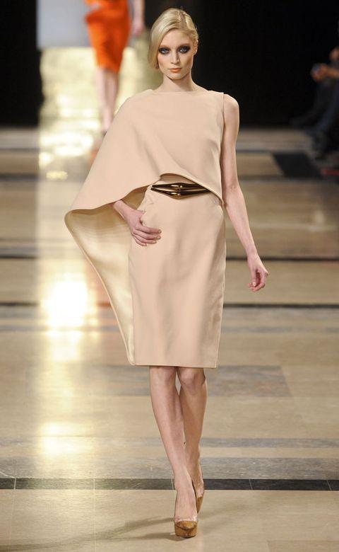Fashion show, Shoulder, Runway, Joint, Human leg, Fashion model, Dress, Style, Waist, Fashion,