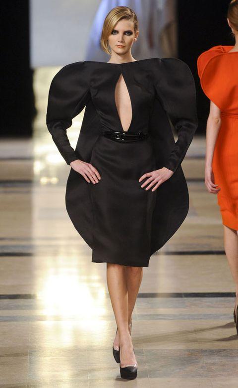 Dress, Human body, Shoulder, Joint, Fashion show, Style, Fashion model, Formal wear, Waist, One-piece garment,