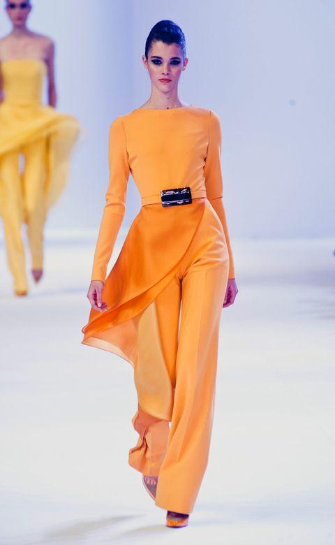 Fashion show, Shoulder, Orange, Joint, Fashion model, Style, Runway, Amber, Waist, Fashion,