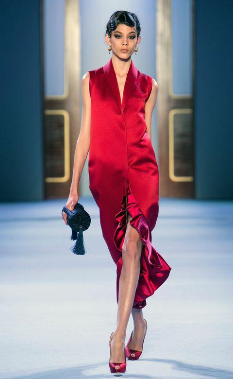 Shoulder, Fashion show, Human leg, Joint, Red, Style, Fashion model, Waist, Runway, Formal wear,