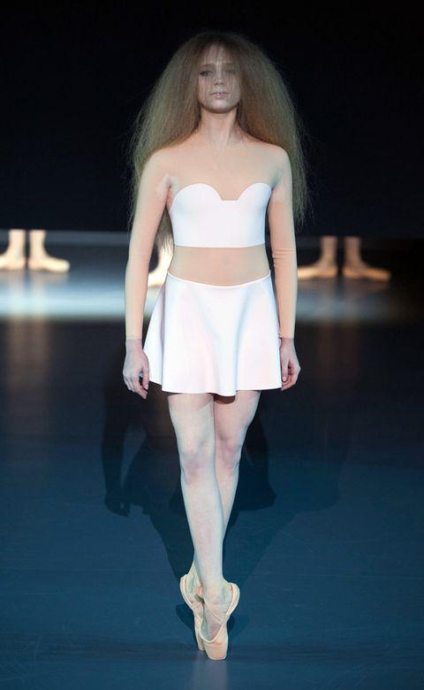 Hairstyle, Skin, Fashion show, Shoulder, Human leg, Joint, Waist, Runway, Style, Fashion model,