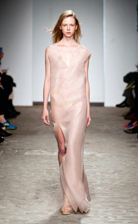 Fashion show, Hairstyle, Shoulder, Joint, Runway, Fashion model, Style, Waist, Dress, Fashion,