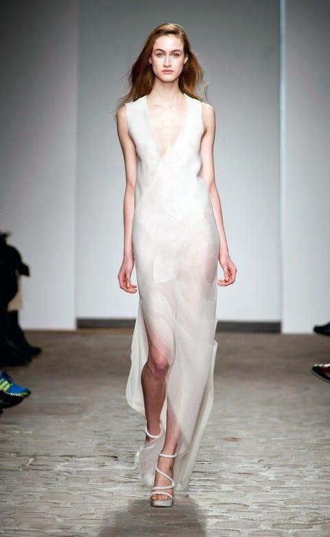 Lip, Shoulder, Fashion show, Joint, Dress, Style, Fashion model, One-piece garment, Runway, Waist,