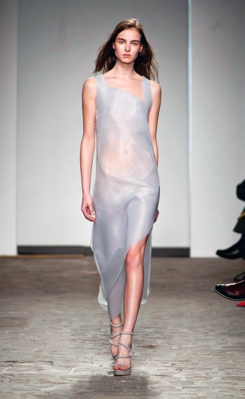 Lip, Shoulder, Joint, Human leg, Fashion show, Style, Fashion model, Waist, Runway, Fashion,