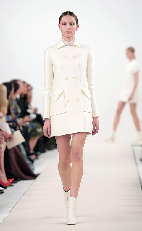 Clothing, Footwear, Leg, Fashion show, Sleeve, Event, Human leg, Runway, Shoulder, Joint,