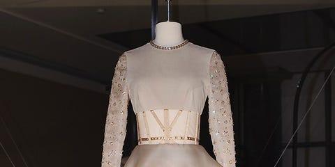 Sleeve, Shoulder, Joint, Style, Fashion, Mannequin, Waist, Fashion model, Costume design, Beige,