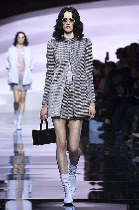 Footwear, Eyewear, Leg, Sleeve, Shoulder, Fashion show, Outerwear, Bag, Style, Fashion model,