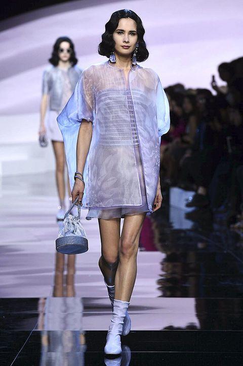Nose, Fashion show, Human body, Shoulder, Runway, Human leg, Outerwear, Fashion model, Jewellery, Style,