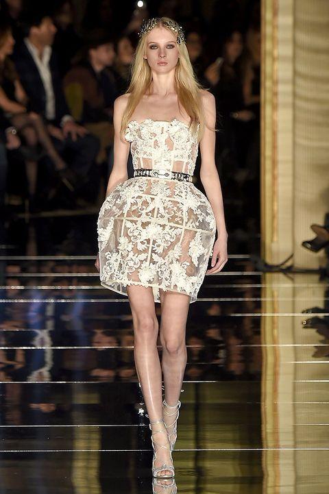 Fashion show, Dress, Shoulder, Human leg, Runway, One-piece garment, Style, Fashion model, Waist, Formal wear,