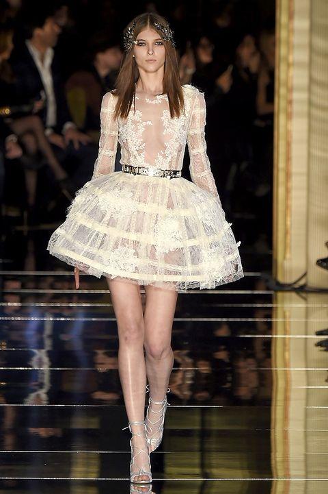 Fashion show, Dress, Runway, Hat, Fashion model, Style, Formal wear, One-piece garment, Waist, Fashion,