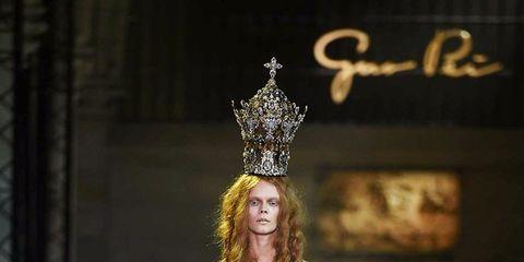 Crown, Headpiece, Hair accessory, Costume design, Headgear, Fashion, Fashion model, Tiara, Haute couture, Gown,