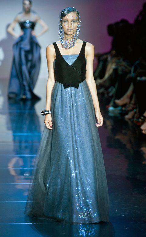 Blue, Hairstyle, Dress, Shoulder, Fashion show, Formal wear, Fashion model, One-piece garment, Style, Gown,