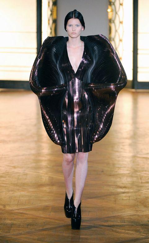 Shoulder, Fashion show, Textile, Outerwear, Flooring, Runway, Floor, Fashion model, Fashion, Wood flooring,