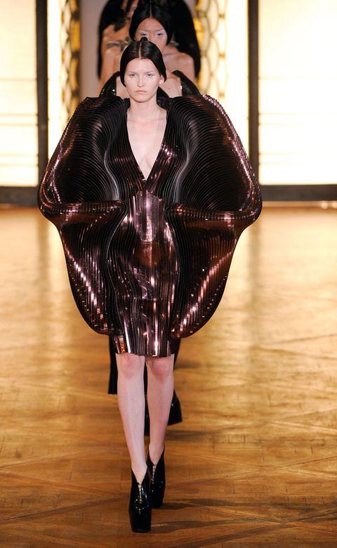 Shoulder, Fashion show, Fashion model, Flooring, Dress, Runway, Fashion, Wood flooring, Model, Fur,