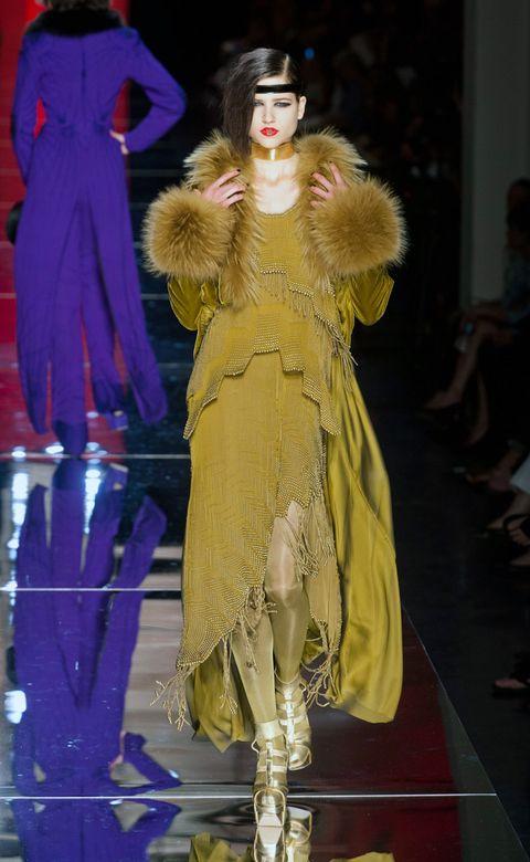 Costume design, Fashion, Dress, Fashion model, Fashion show, Fur, Costume, Public event, Fashion design, Natural material,
