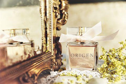 Metal, Brass, Perfume, Still life photography, Floral design, Silver, Natural material, Bronze, Cosmetics, Flower Arranging,