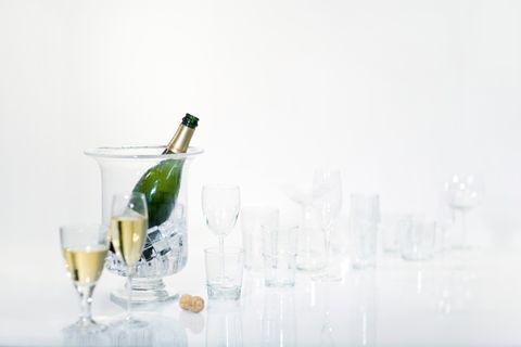 Drinkware, Glass, Glass bottle, Fluid, Bottle, Barware, Drink, Alcohol, Alcoholic beverage, Stemware,