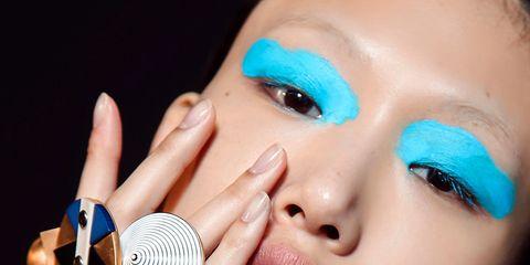 Audio equipment, Blue, Finger, Lip, Cheek, Microphone, Electronic device, Eyelash, Music artist, Technology,
