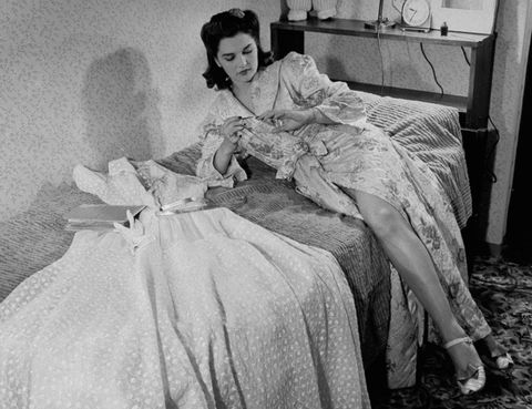 Human, Style, Sitting, Linens, Vintage clothing, Bed sheet, Monochrome, Bed, Gown, Bedroom,