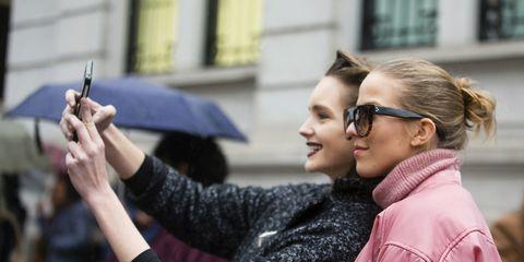 Clothing, Eyewear, Glasses, Sleeve, Jacket, Textile, Hand, Outerwear, Sunglasses, Street fashion,