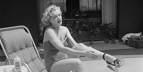 White, Photograph, Black, Sitting, Leg, Black-and-white, Monochrome, Retro style, Human leg, Footwear,