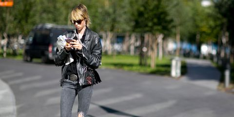 Jacket, Textile, Denim, Outerwear, Road surface, Camera, Style, Street, Street fashion, Bag,
