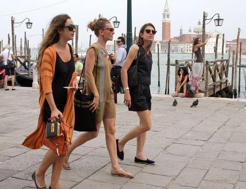 Clothing, Eyewear, Vision care, Leg, Sunglasses, Tourism, Bag, Human leg, Style, Summer,