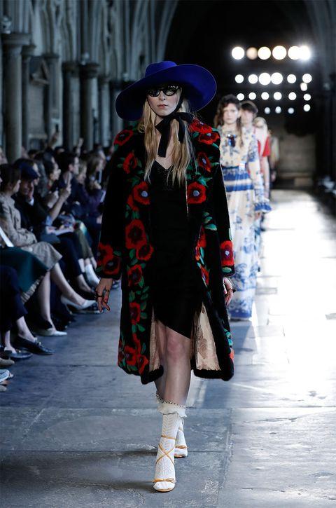 Clothing, Leg, Hat, Fashion show, Textile, Outerwear, Winter, Runway, Fashion model, Style,
