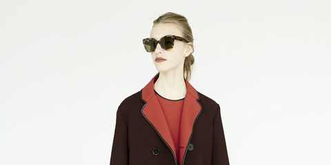 Clothing, Eyewear, Vision care, Coat, Collar, Sleeve, Hand, Sunglasses, Joint, Outerwear,