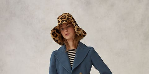 Clothing, Hat, Collar, Sleeve, Coat, Textile, Outerwear, Style, Formal wear, Blazer,