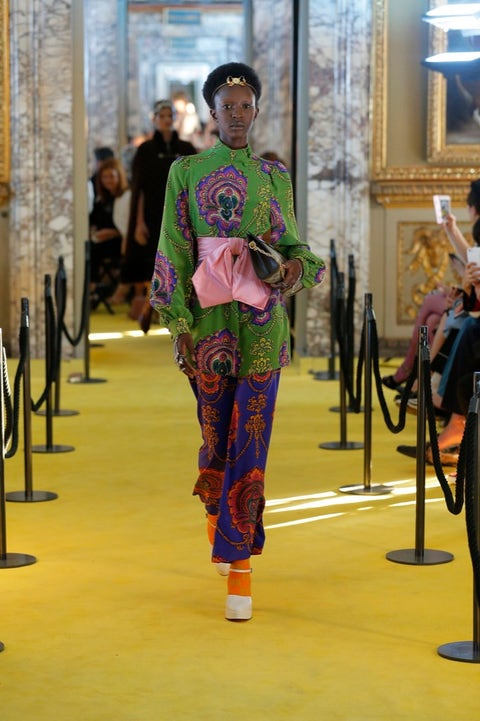 Temple, Picture frame, Fashion design, Visual arts, Costume, Silk, Carpet, Balance,