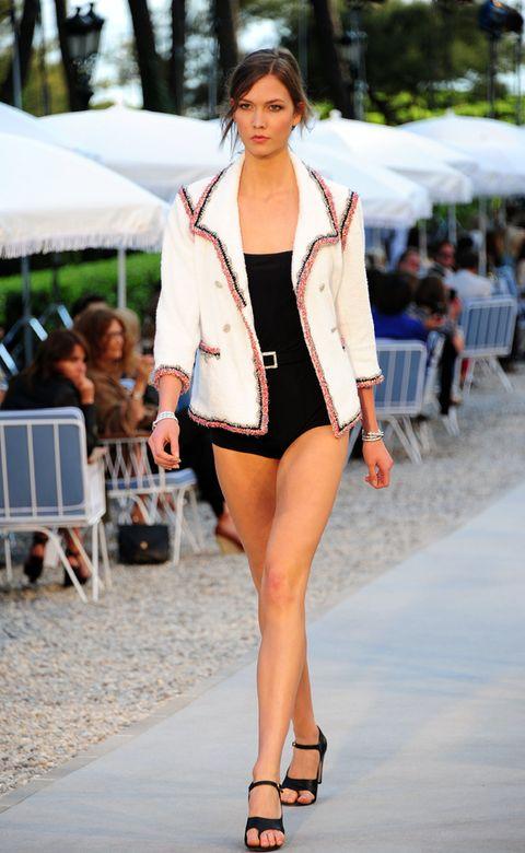 Leg, Fashion show, Human leg, Shoulder, Joint, Outerwear, Fashion model, Style, Runway, Summer,